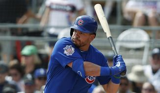 In this  Friday, March 15, 2019 file photo, Chicago Cubs' Kyle Schwarber bats during a spring training baseball game against the Chicago White Sox in Glendale, Ariz. Kyle Schwarber and Albert Almora Jr. became free agents Wednesday, Dec. 2, 2020 when the Chicago Cubs declined to offer contracts to two key players from their historic 2016 World Series championship. (AP Photo/Sue Ogrocki, File)  **FILE**