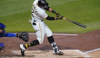 Pittsburgh Pirates' Erik Gonzalez drives in a run with a double off Chicago Cubs starting pitcher Jose Quintana during the second inning of a baseball game in Pittsburgh, Tuesday, Sept. 22, 2020. (AP Photo/Gene J. Puskar)