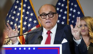 In this Nov. 19, 2020, file photo, former New York Mayor Rudy Giuliani, a lawyer for President Donald Trump, speaks during a news conference at the Republican National Committee headquarters, in Washington. (AP Photo/Jacquelyn Martin, File)  **FILE**