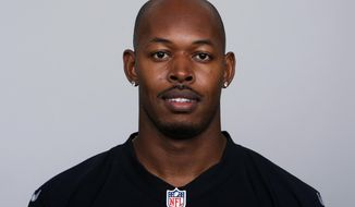 FILE- This is a 2014 file photo shows Carlos Rogers of the Oakland Raiders NFL football team.  Rogers pleaded guilty Monday, Nov. 30, 2020, in federal court in Lexington, Ky., to one charge of conspiring to defraud a program set up to reimburse former players for out-of-pocket medical expenses, the Lexington Herald-Leader reported. (AP Photo/File)