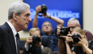 In this Wednesday, July 24, 2019, file photo, former special counsel Robert Mueller returns to the witness table following a break in his testimony before the House Intelligence Committee on Capitol Hill in Washington. NBC announced Wednesday, Dec. 2, 2020, that Mueller, the former special counsel who looked into Russian interference in the 2016 election, has given an extensive interview that debuts in early December. (AP Photo/Susan Walsh, File)