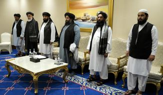 In this file photo, members of the Taliban's peace negotiation team meet with Secretary of State Mike Pompeo amid talks between the Taliban and the Afghan government, Saturday, Nov. 21, 2020, in Doha, Qatar. (AP Photo/Patrick Semansky, Pool)  **FILE**