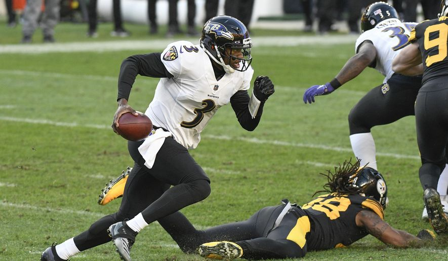 Baltimore Ravens quarterback Robert Griffin III (3) scrambles past Pittsburgh Steelers outside linebacker Bud Dupree (48) during the first half of an NFL football game, Wednesday, Dec. 2, 2020, in Pittsburgh. (AP Photo/Don Wright)