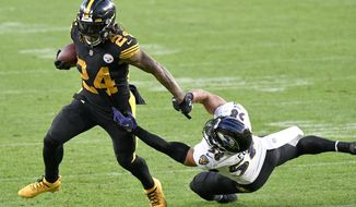 Pittsburgh Steelers running back Benny Snell (24) runs away from Baltimore Ravens outside linebacker L.J. Fort (58) during the first half of an NFL football game, Wednesday, Dec. 2, 2020, in Pittsburgh. (AP Photo/Don Wright)