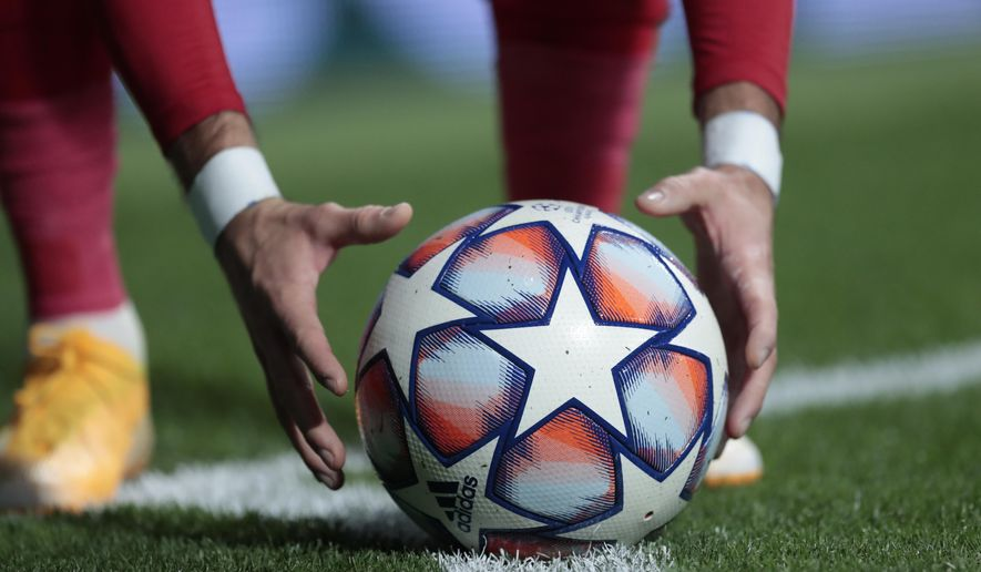 Atletico Madrid's Yannick Carrasco holds ball during the Champions League group A soccer match between Atletico Madrid and Bayern Munich at the Wanda Metropolitano stadium in Madrid, Spain, Tuesday, Dec. 1, 2020. (AP Photo/Bernat Armangue)