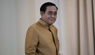 Thailand's Prime Minister Prayuth Chan-ocha arrives to speak to the media during a press conference at Government House in Bangkok, Thailand, Tuesday, Dec. 1, 2020. (AP Photo/Sakchai Lalit)