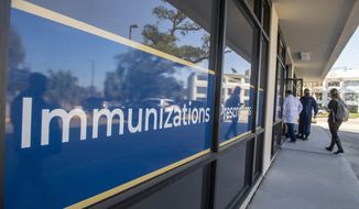 Outside the LaPharmacy in Elmwood, La., Wednesday, Dec. 2, 2020. Coronavirus tests are offered here and this location will eventually give the vaccine once it becomes available. (Chris Granger/The Advocate via AP)