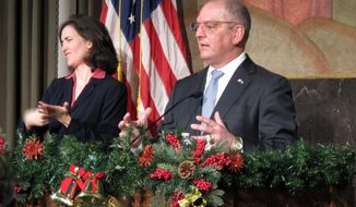Louisiana Gov. John Bel Edwards, with a sign language interpreter to his left, speaks at his latest briefing on COVID-19, Wednesday, Dec. 2, 2020, in Baton Rouge, La. (AP Photo/Melinda Deslatte)