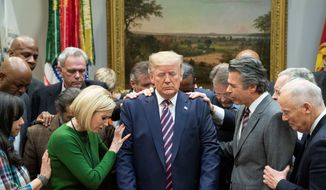 Evangelicals cast about 23 million votes, according to a researcher. The bloc enthusiastically voted in favor of President Trump. (Associated Press)
