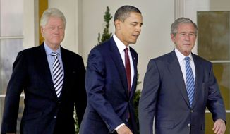 In this Jan. 16, 2010, file photo President Barack Obama, center, walks out of the Oval Office of the White House with former Presidents Bill Clinton, left, and George W. Bush, right, to deliver remarks in the Rose Garden at the White House in Washington. Three former presidents say they'd be willing to take a coronavirus vaccine publicly, once one becomes available, to encourage all Americans to get inoculated against a disease that has already killed more than 273,000 people nationwide. (AP Photo/Pablo Martinez Monsivais, File)