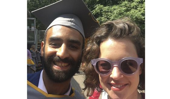 In this 2018 photo taken in London shows Karim Ennarah and his now-wife Jess Kelly posing for a photograph after they graduated from the School of Oriental and African Studies.  The acting director of a prominent Egyptian rights group says its three staffers, Ennara, Executive director Gasser Abdel-Razek and Mohammed Bashir, who were arrested last month have been freed on Thursday, Dec. 3, 2020.  They were arrested in November after EIPR hosted foreign diplomats to discuss the human rights situation in Egypt. They were charged with terrorism and spreading false information. (Courtesy of Jess Kelly via AP)