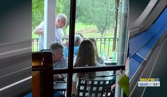 Democratic Louisiana Gov. John Bel Edwards defended himself Wednesday after he was recently spotted chatting with others without wearing a mask at a private country club. (Screenshot via WAFB)