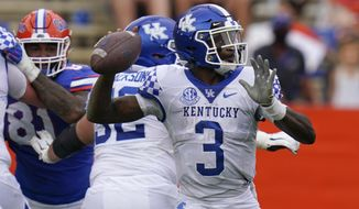 Kentucky quarterback Terry Wilson (3) looks for a receiver against Florida during the first half of an NCAA college football game, Saturday, Nov. 28, 2020, in Gainesville, Fla. (AP Photo/John Raoux)