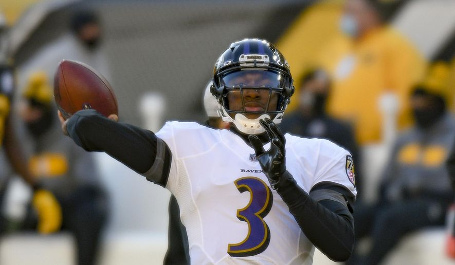 Baltimore Ravens quarterback Robert Griffin III (3) warms up before an NFL football game against the Pittsburgh Steelers, Wednesday, Dec. 2, 2020, in Pittsburgh. (AP Photo/Don Wright) **FILE**