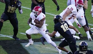 Rutgers running back Isaih Pacheco (1) runs past Purdue cornerback Cam Allen (18) during the first quarter of an NCAA college football game in West Lafayette, Ind., Saturday, Nov. 28, 2020. (AP Photo/Michael Conroy)