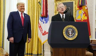 Former college coach Lou Holtz, speaks before President Donald Trump awarded him the medal of Freedom, the highest civilian honor, in the Oval Office at the White House, Thursday, Dec. 3, 2020, in Washington. Holtz had a storied 34-year coaching career that included winning the 1988 national title at the University of Notre Dame. (AP Photo/Evan Vucci)