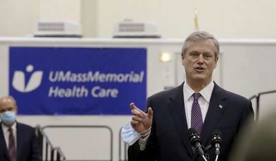 Gov. Charlie Baker speaks after touring the DCU Center as it gears up to be used as a COVID-19 field hospital for the second time on Thursday, Dec. 3, 2020, in Worcester, Mass. (Nancy Lane/The Boston Herald via AP, Pool) ** FILE **
