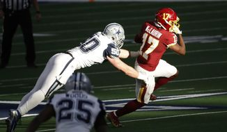Dallas Cowboys linebacker Sean Lee (50) dives in an attempt to tackle Washington Football Team wide receiver Terry McLaurin (17) during the first half of an NFL football game in Arlington, Texas, Thursday, Nov. 26, 2020. The ever-improving route-running, the key catches and the scores are what Washington pays Terry McLaurin for on game days -- and the sorts of things that get plenty of attention around the NFL and from fans.(AP Photo/Roger Steinman)