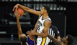 Iowa forward Keegan Murray (15) blocks a shot by Western Illinois guard Justin Brookens (3) during the first half of an NCAA college basketball game, Thursday, Dec. 3, 2020, in Iowa City, Iowa. (AP Photo/Charlie Neibergall)