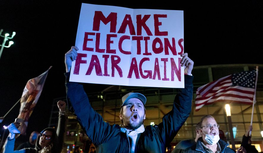 A supporter of President Donald Trump chants during a protest against the election results outside the central counting board at the TCF Center in Detroit, Nov. 5, 2020. (AP Photo/David Goldman) ** FILE **