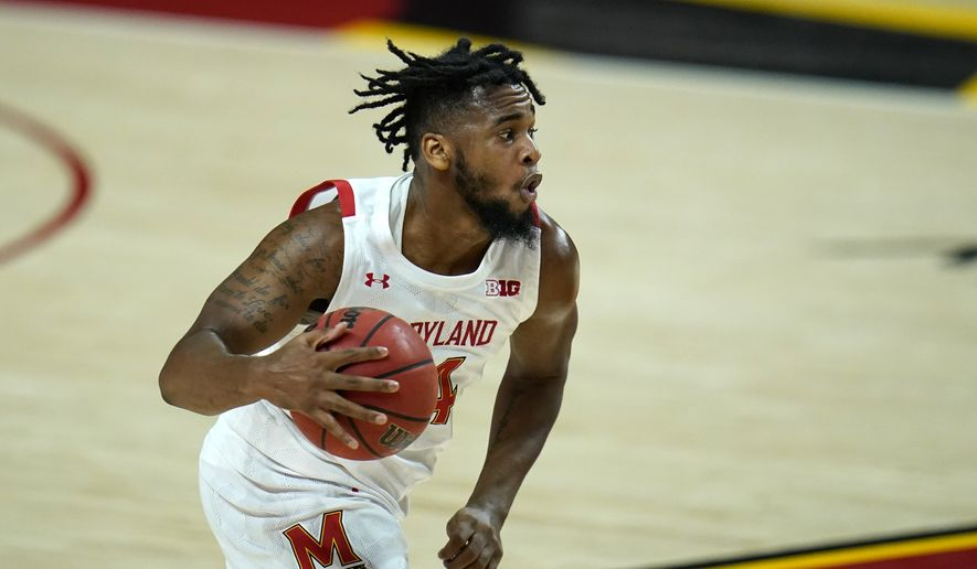 Maryland forward Donta Scott drives to the basket against St. Peter's during the second half of an NCAA college basketball game, Friday, Dec. 4, 2020, in College Park, Md. Maryland won 90-57. (AP Photo/Julio Cortez) **FILE**