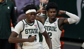 Michigan State forward Gabe Brown (44) and guard Rocket Watts (2) react after a play during the first half of the team's NCAA college basketball game against Detroit Mercy, Friday, Dec. 4, 2020, in East Lansing, Mich. (AP Photo/Carlos Osorio)