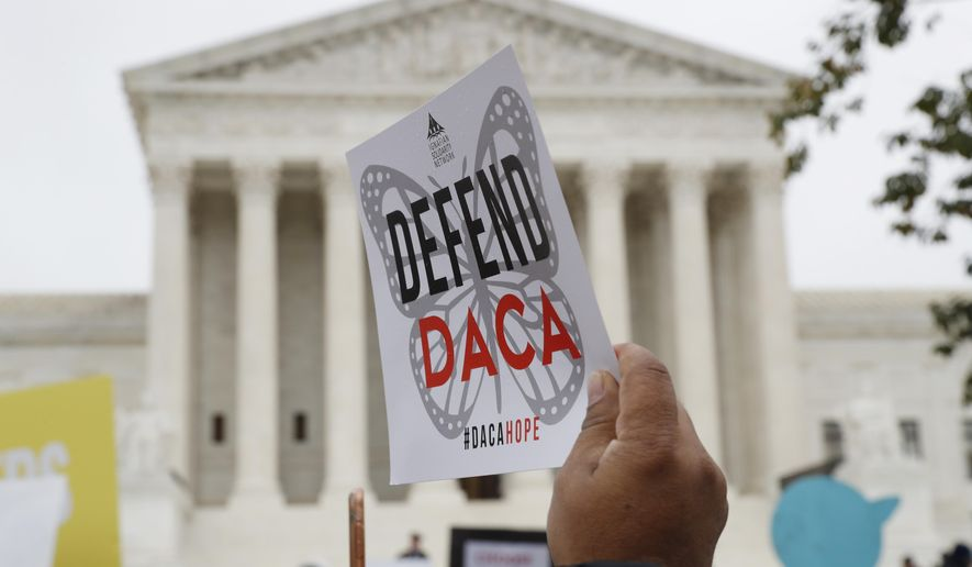 FILE - In this Nov. 12, 2019, file photo people rally outside the Supreme Court as oral arguments are heard in the case of President Trump's decision to end the Obama-era, Deferred Action for Childhood Arrivals program (DACA), at the Supreme Court in Washington. The Trump administration must accept new applications for the Deferred Action for Childhood Arrivals program that protects some young immigrants from deportation, a federal judge ruled Friday, Dec. 4, 2020 in vacating a memo from the acting Homeland Security secretary that had suspended it. (AP Photo/Jacquelyn Martin, File)