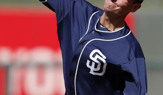 FILE - In this March 1, 2018, file photo, San Diego Padres pitcher Chris Young throws during the third inning of a spring training baseball game against the Texas Rangers in Surprise, Ariz. The Rangers hired Young as executive vice president and general manager Friday, Dec. 4, 2020, bringing the Major League Baseball executive home to work under president of baseball operations Jon Daniels, the club's GM since 2005. (AP Photo/Charlie Neibergall, File)