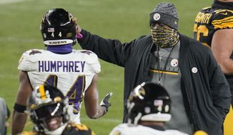 Pittsburgh Steelers coach Mike Tomlin, right, greets Baltimore Ravens cornerback Marlon Humphrey (44) after an NFL football game Wednesday, Dec 2, 2020, in Pittsburgh. The Steelers won 19-14. (AP Photo/Gene J. Puskar)