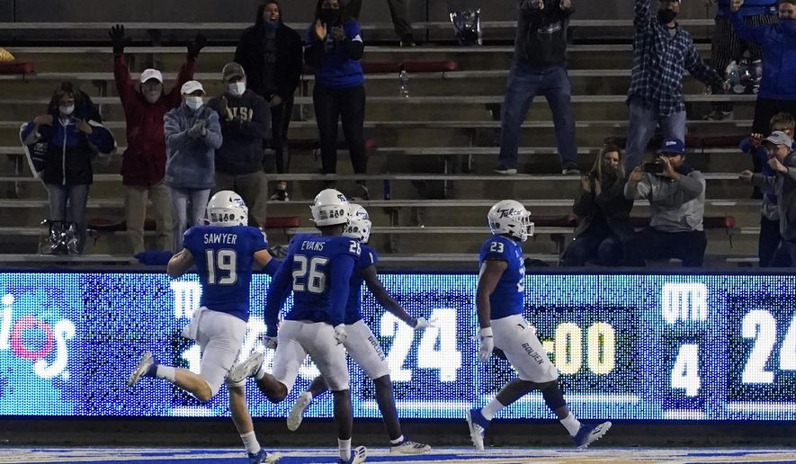 Tulsa fans cheer as linebacker Zaven Collins (23) returns an interception for a touchdown during the second overtime of the team's NCAA college football game against Tulane in Tulsa, Okla., Thursday, Nov. 19, 2020. (AP Photo/Sue Ogrocki)