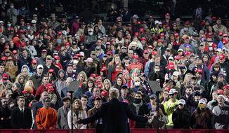 President Donald Trump speaks at a campaign rally for Senate Republican candidates, Sen. Kelly Loeffler, R-Ga., and Sen. David Perdue, R-Ga., at Valdosta Regional Airport, Saturday, Dec. 5, 2020, in Valdosta, Ga. (AP Photo/Evan Vucci)
