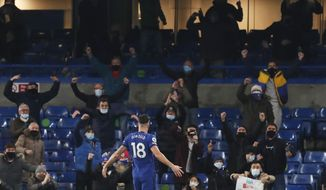 Chelsea's Olivier Giroud celebrates after scoring his side's first goal during the English Premier League soccer match between between Chelsea and Leeds United at Stamford Bridge in London, England, Saturday, Dec. 5, 2020. (Matthew Childs/Pool via AP)