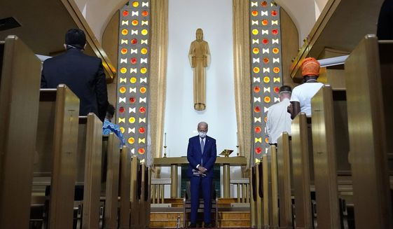 In this Thursday, Sept. 3, 2020 file photo, Democratic presidential candidate former Vice President Joe Biden bows his head in prayer at Grace Lutheran Church in Kenosha, Wis.  (AP Photo/Carolyn Kaster)  **FILE**
