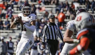 Texas A&M quarterback Kellen Mond (11) looks to pass against Auburn during the first half of an NCAA college football game on Saturday, Dec. 5, 2020, in Auburn, Ala. (AP Photo/Butch Dill)
