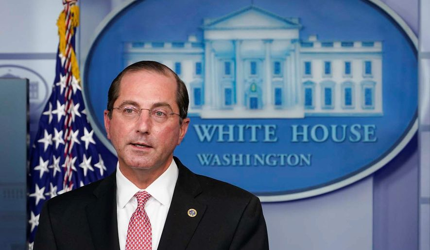 """""""What we've said is within 24 hours of FDA greenlighting with authorization we'll ship to all of the states and territories that we work with,"""" said Health and Human Services Secretary Alex M. Azar II. (ASSOCIATED PRESS)"""