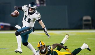 Green Bay Packers' Rashan Gary tries to stop Philadelphia Eagles' Carson Wentz during the first half of an NFL football game Sunday, Dec. 6, 2020, in Green Bay, Wis. (AP Photo/Matt Ludtke)  **FILE**