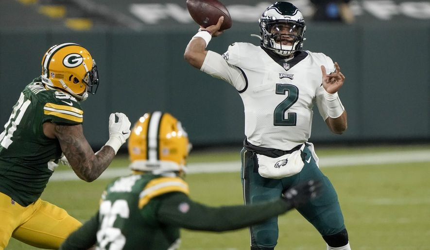Philadelphia Eagles' Jalen Hurts throws during the second half of an NFL football game against the Green Bay Packers Sunday, Dec. 6, 2020, in Green Bay, Wis. (AP Photo/Morry Gash)