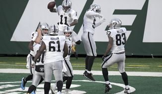 Las Vegas Raiders' Henry Ruggs III, top left, celebrates his touchdown with teammates during the second half an NFL football game against the New York Jets, Sunday, Dec. 6, 2020, in East Rutherford, N.J. (AP Photo/Bill Kostroun)