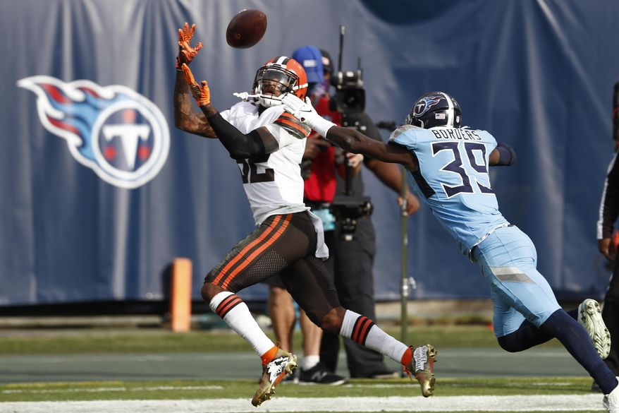 Cleveland Browns wide receiver Rashard Higgins (82) caches a 17-yard touchdown pass ahead of Tennessee Titans cornerback Breon Borders (39) in the first half of an NFL football game Sunday, Dec. 6, 2020, in Nashville, Tenn. (AP Photo/Wade Payne)