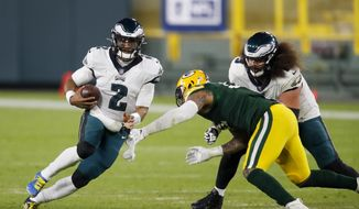 Philadelphia Eagles' Jalen Hurts runs during the second half of an NFL football game against the Green Bay Packers Sunday, Dec. 6, 2020, in Green Bay, Wis. The Packers won 30-16. (AP Photo/Matt Ludtke) **FILE**