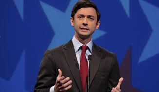 Democratic challenger Jon Ossoff speaks during a debate for U.S. Senate on Sunday, Dec. 6, 2020, in Atlanta. Sen. David Perdue declined to attend the debate. (AP Photo/Ben Gray, Pool)