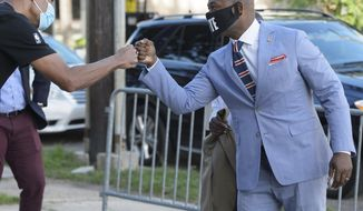 New Orleans City Councilperson Jason Williams arrives at the Clerk of Criminal District Courts to qualify for the Orleans Parish DA race in New Orleans, La. Wednesday, July 22, 2020. (Max Becherer/The Advocate via AP)