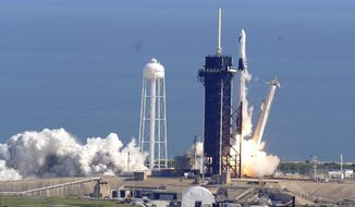 A SpaceX Falcon 9 rocket on a resupply mission to the International Space Station lifts off from pad 39A at the Kennedy Space Center in Cape Canaveral, Fla., Sunday, Dec. 6, 2020. (AP Photo/John Raoux)