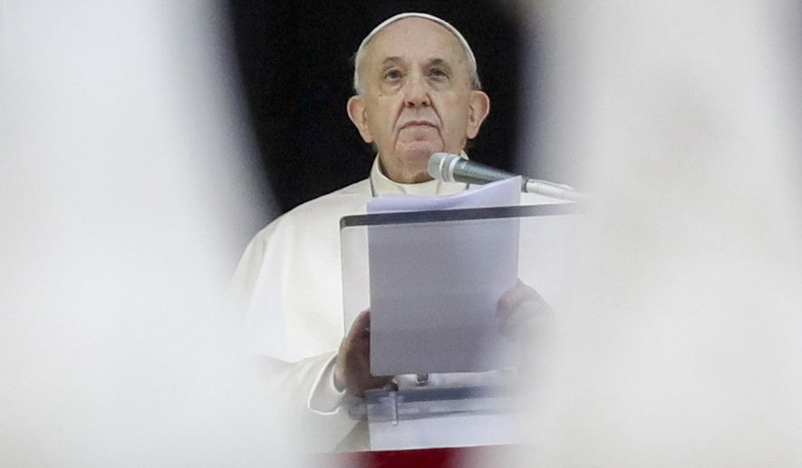Pope Francis recites the Angelus noon prayer from the window of his studio overlooking St.Peter's Square, at the Vatican, Sunday, Dec. 6, 2020. (AP Photo/Andrew Medichini)