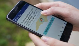 North Carolina' s cell phone app contact tracing SlowCOVIDNC is shown on Friday, Dec. 4, 2020, in Charlotte, N.C. An analysis shows that few Americans are utilizing contact tracing technology launched in a host of U.S. states and territories. (AP Photo/Chris Carlson)