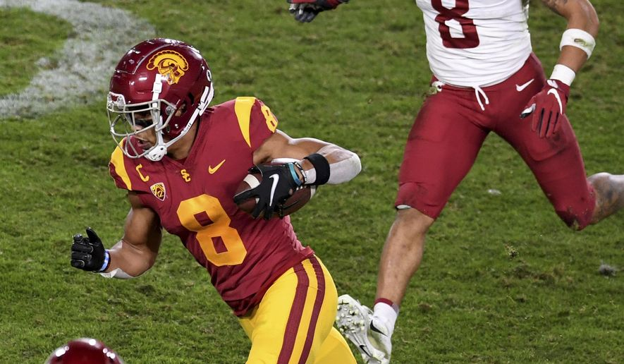 Southern California wide receiver Amon-Ra St. Brown (8) runs for a first down against Washington State in the second half of an NCAA college football game in Los Angeles, Sunday, Dec. 6, 2020. (Keith Birmingham/The Orange County Register via AP)