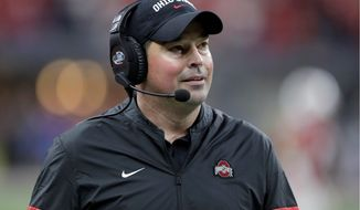 Coach Ryan Day and Ohio State are in danger of having to scrap Saturday's game against Michigan due to a coronavirus outbreak.  (ASSOCIATED PRESS)