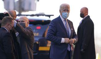 President-elect Joe Biden arrives at The Queen theater in Wilmington, Del., Monday, Dec. 7, 2020. (AP Photo/Susan Walsh)