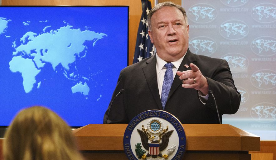 In this Nov. 10, 2020, file photo, Secretary of State Mike Pompeo gestures toward a reporter while speaking at the State Department in Washington. (AP Photo/Jacquelyn Martin, Pool) ** FILE **