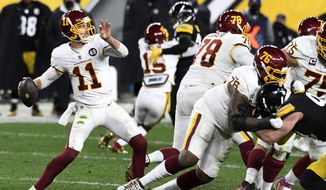 Washington Football Team quarterback Alex Smith (11) throws a pass during the second half of an NFL football game against the Pittsburgh Steelers in Pittsburgh, Monday, Dec. 7, 2020. Washington won 23-17. (AP Photo/Barry Reeger)